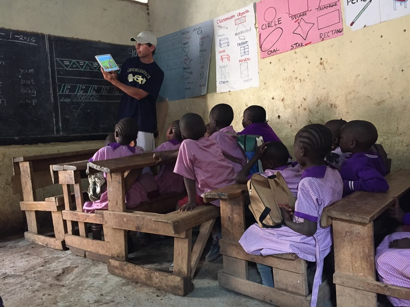 Golf-Kenya_trip-Seth_Reeves_sharing_a_Bible_story