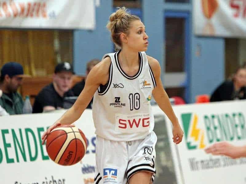 Women's Professional Basketball Player dribbling