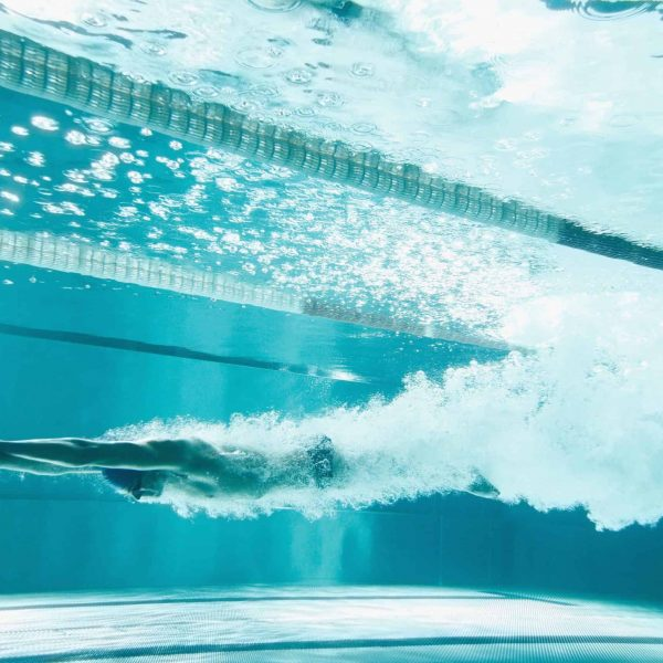 Swimmer underwater after the jump